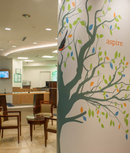 A tree graphic was designed to communicate the vitality and growth of HealthOne. The American Robin is the Michigan State Bird.